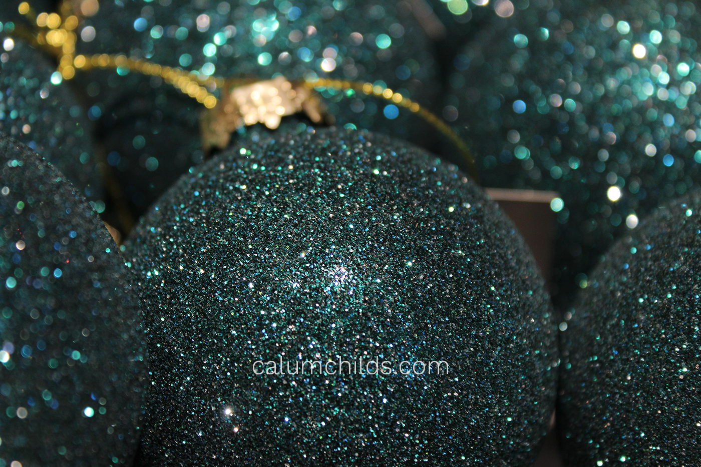 A bauble covered in blue glitter.