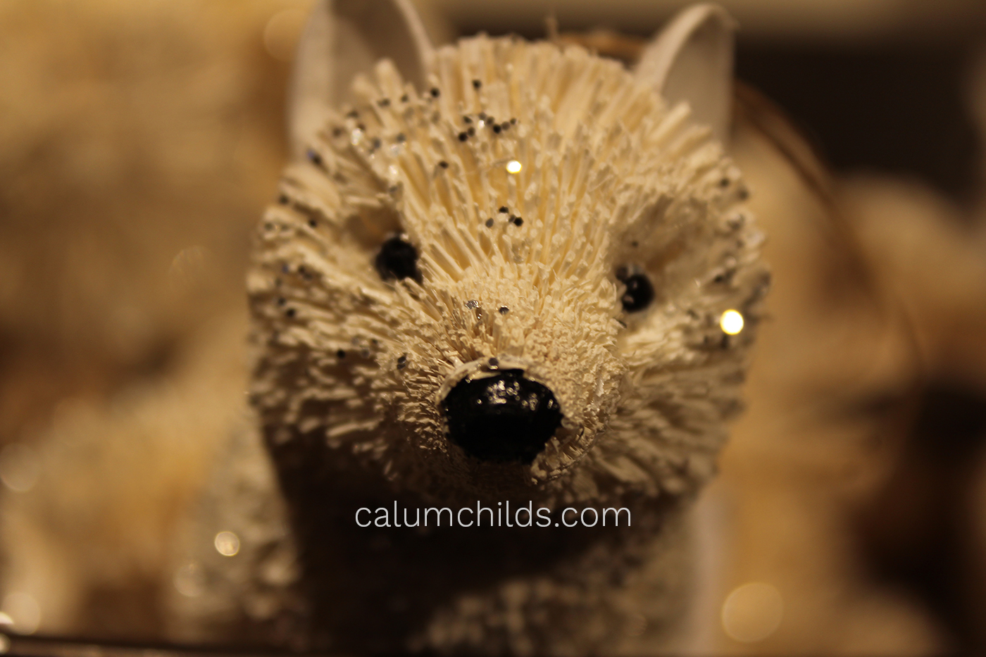 A decoration that looks like a dog seems to stares directly at the camera