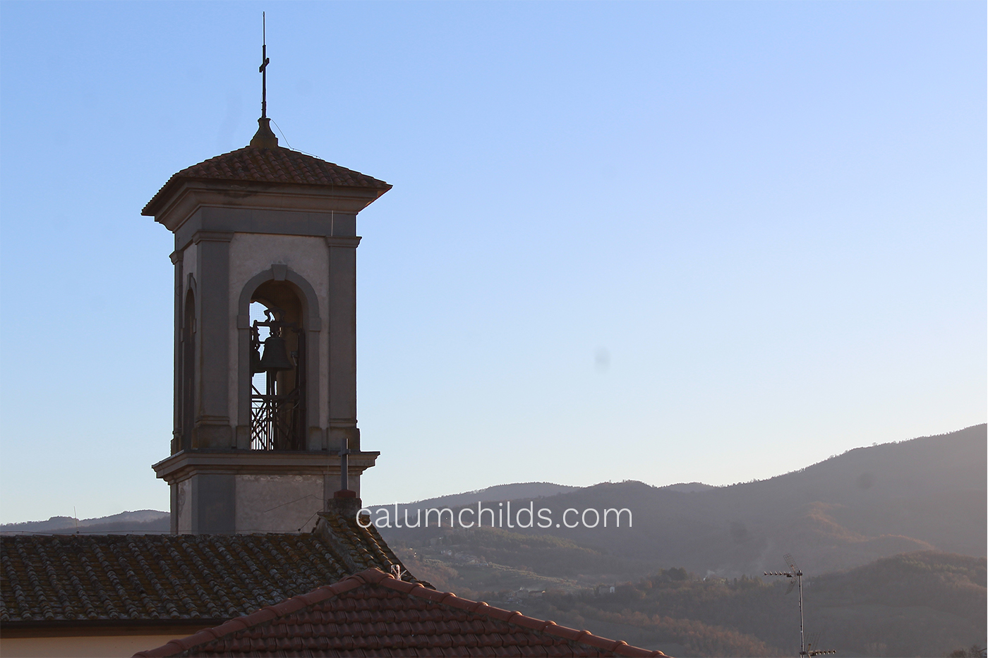A church spire (left) and a view of the mountains (right).